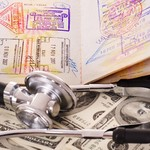 Medical still life with stethoscope, money and passport.