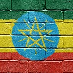 Flag of Ethiopia on brick wall