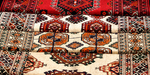 Few handmade carpets with traditional ornament.