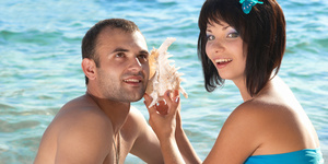 Young couple with seashell