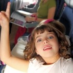 little girl inside aircraft rising up finger