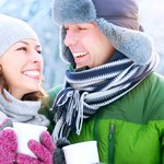 Happy Couple with Hot Drinks Outdoors. Winter Vacation